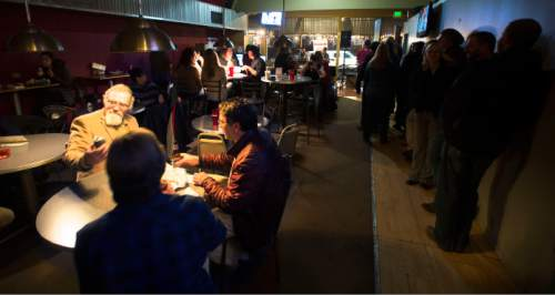 Steve Griffin  |  The Salt Lake Tribune  Guests enjoy a final round during Fats Grill's last night of business in Salt Lake City, Wednesday, December 30, 2015. The long time bar and grill will be torn down and be replaced by a office tower.