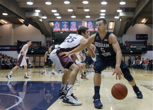 BYU guard Kyle Collinsworth (5) drives on Saint Mary's (Calif.) guard Joe Rahon (25) during the first half of an NCAA college basketball game in Moraga, Calif., Thursday, Dec. 31, 2015. (AP Photo/Jeff Chiu)