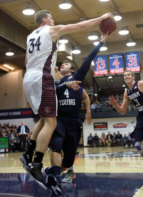 Saint Mary's center Jock Landale (34) defends a shot by BYU guard Nick Emery (4) during the first half of an NCAA college basketball game in Moraga, Calif., Thursday, Dec. 31, 2015. (AP Photo/Jeff Chiu)