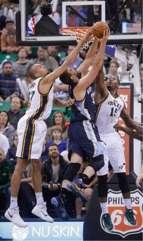 Utah Jazz's Rudy Gobert, left, and Derrick Favors (15) block the shot of Memphis Grizzlies center Marc Gasol, center, during the second half of an NBA basketball game Saturday, Nov. 7, 2015, in Salt Lake City. The Jazz won 89-79. (AP Photo/Rick Bowmer)
