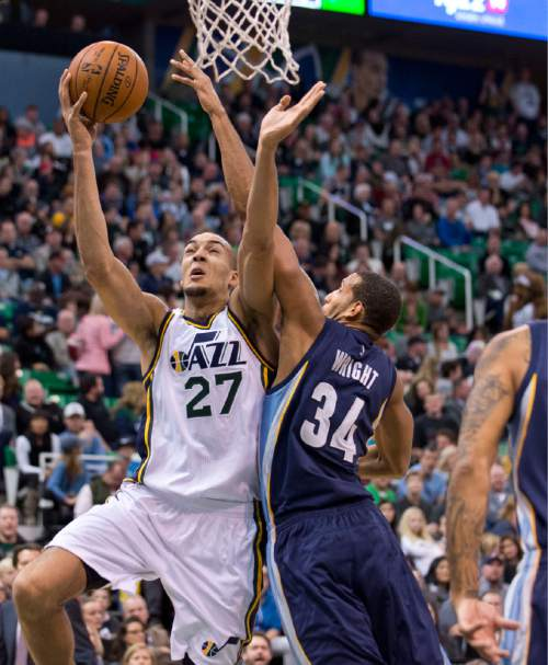 Lennie Mahler  |  The Salt Lake Tribune  Utah center Rudy Gobert gets past Memphis center Brandan Wright in the first half of a game against the Memphis Grizzlies at Vivint Smart Home Arena on Saturday, Nov. 7, 2015.