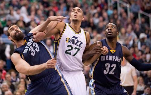 Lennie Mahler  |  The Salt Lake Tribune  Memphis center Marc Gasol, Utah center Rudy Gobert, and Memphis forward Jeff Green fight for a rebound in the first half of a game at Vivint Smart Home Arena on Saturday, Nov. 7, 2015.
