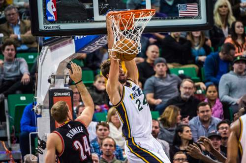 Chris Detrick  |  The Salt Lake Tribune Utah Jazz center Jeff Withey (24) dunks past Portland Trail Blazers center Mason Plumlee (24) during the game at Vivint Smart Home Arena Thursday December 31, 2015.