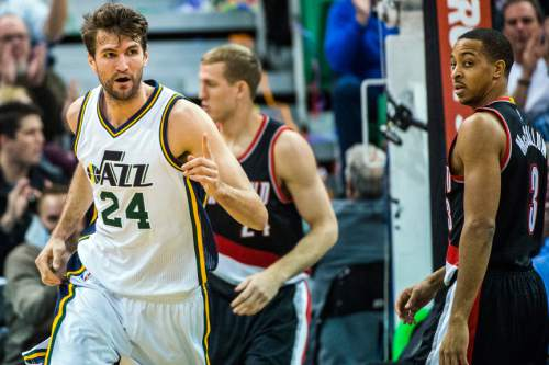 Chris Detrick  |  The Salt Lake Tribune Utah Jazz center Jeff Withey (24) celebrates after his dunk as Portland Trail Blazers guard C.J. McCollum (3) looks on during the game at Vivint Smart Home Arena Thursday December 31, 2015.