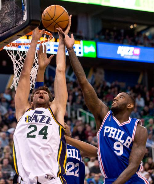 Lennie Mahler  |  The Salt Lake Tribune  Jazz center Jeff Withey is fouled on a rebound by JaKarr Sampson in the first half of a game against the Philadelphia 76ers at Vivint Smart Home Arena, Monday, Dec. 28, 2015.