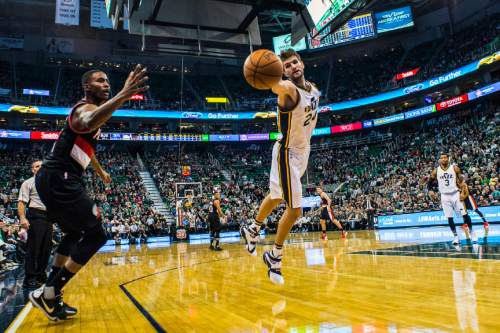Chris Detrick  |  The Salt Lake Tribune Utah Jazz center Jeff Withey (24) and Portland Trail Blazers forward Maurice Harkless (4) go for the ball during the game at Vivint Smart Home Arena Thursday December 31, 2015.