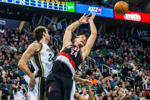 Chris Detrick  |  The Salt Lake Tribune Utah Jazz center Jeff Withey (24) blocks Portland Trail Blazers center Mason Plumlee (24) during the game at Vivint Smart Home Arena Thursday December 31, 2015.