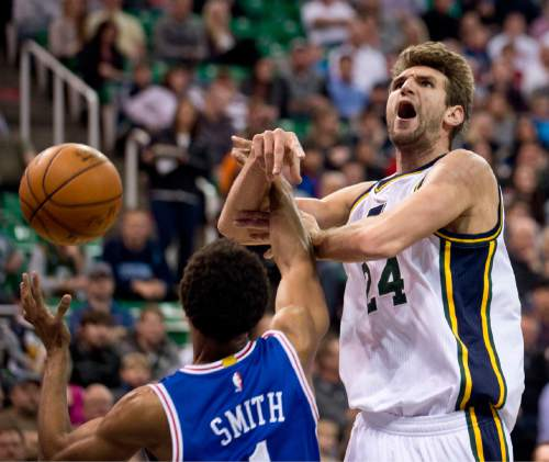 Lennie Mahler  |  The Salt Lake Tribune  Jazz center Jeff Withey draws a foul from Ish Smith in the first half of a game against the Philadelphia 76ers at Vivint Smart Home Arena, Monday, Dec. 28, 2015.