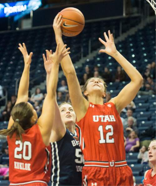 Rick Egan  |  The Salt Lake Tribune  Utah Utes forward Emily Potter (12) grabs a rebound, Brigham Young Cougars center Macayla Hanks (50)in basketball action, BYU vs. Utah, in the Marriott Center, Saturday, December 12, 2015.
