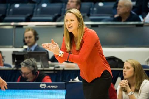 Rick Egan  |  The Salt Lake Tribune  First-year Utah head coach Lynne Roberts gives encouragement to her team, in basketball action, BYU vs. Utah, in the Marriott Center, Saturday, December 12, 2015.