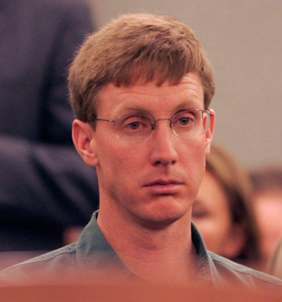 Nephi Jeffs, younger brother of Warren Jeffs, sits tense in the courtroom before the hearing. Handcuffed and flanked by Las Vegas Metro PD Swat officers, FLDS leader Warren Jeffs appeared before Judge James M. Bixler in the Clark County Regional Justice Center this morning and waived an extradition hearing, agreeing to be returned to Utah to face charges related to allegedly arranging an underage marriage.  Photo by Trent Nelson; 8.31.2006