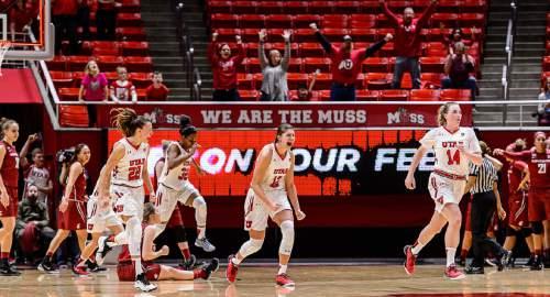 Trent Nelson  |  The Salt Lake Tribune Utah players celebrate the win as the University of Utah hosts Washington State, NCAA women's basketball at the Huntsman Center, Saturday January 2, 2016.