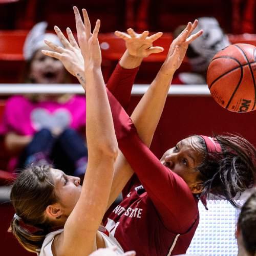 Trent Nelson  |  The Salt Lake Tribune Utah Utes forward Emily Potter (12) defends Washington State Cougars forward Nike McClure (21) in the third quarter as the University of Utah hosts Washington State, NCAA women's basketball at the Huntsman Center, Saturday January 2, 2016.