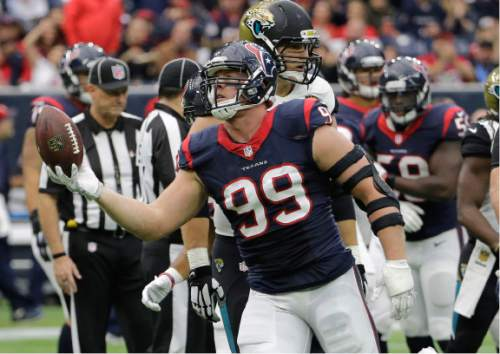 Houston Texans defensive end J.J. Watt (99) hold the football after recovering a Jacksonville Jaguars fumble during the first half an NFL football game Sunday, Jan. 3, 2016, in Houston. (AP Photo/David J. Phillip)