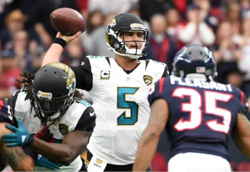 Jacksonville Jaguars quarterback Blake Bortles (5) throws against the Houston Texans during the first half of an NFL football game, Sunday, Jan. 3, 2016, in Houston. (AP Photo/Eric Christian Smith)