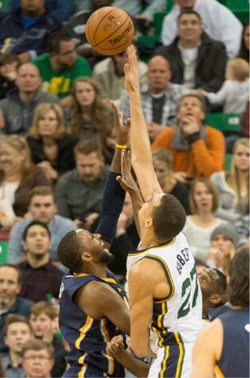 Rick Egan     The Salt Lake Tribune  Utah Jazz center Rudy Gobert (27) blocks a shot by Indiana Pacers guard C.J. Miles (0), in NBA action, Utah vs Indiana, at EnergySolutions Arena, Monday, January 5, 2015