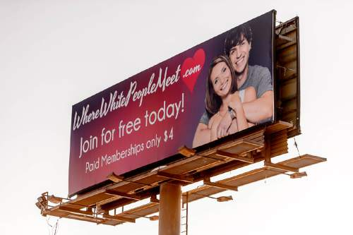 Trent Nelson  |  The Salt Lake Tribune A billboard for WhereWhitePeopleMeet.com, near 5600 West and 2100 South in West Valley City, Thursday December 31, 2015.