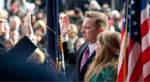Steve Griffin  |  The Salt Lake Tribune   Salt Lake City Council member Andre Johnston takes the Oath of Office administered by Sate of Utah District Court Judge W. Brent West, during ceremony at the City & County Building in Salt Lake City, Monday, January 4, 2016.