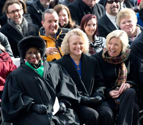 Steve Griffin  |  The Salt Lake Tribune  Salt Lake Mayor Jackie Biskupski, laughs with her fiancee Betty Iverson, right, and Salt Lake County Presiding Judge, Shauna Graves-Robertson, left, during Oath of Office Ceremony for her and council members Andrew Johnston, Derek Kitchen and Charlie Luke at the City & County Building in Salt Lake City, Monday, January 4, 2016.