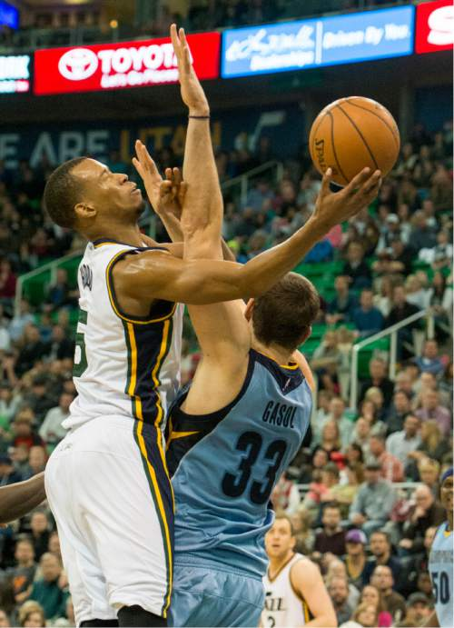 Rick Egan  |  The Salt Lake Tribune  Utah Jazz guard Rodney Hood (5) is fouled by Memphis Grizzlies center Marc Gasol (33), as the Jazz win 92-87, in overtime, in NBA action Utah Jazz vs. The Memphis Grizzlies in Salt Lake City, Saturday, January 2, 2016. Hood finished with 32 points.