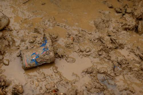 In this picture taken Monday, Jan. 4, 2016, a boot from a Syrian refugee boy is covered in mud after heavy rain at a refugee camp in the town of Hosh Hareem, in the Bekaa valley, east Lebanon. A snowstorm engulfed Lebanon on the first day of the new year, cutting off mountain roads, isolating villages and worsening living conditions for tens of thousands of Syrian refugees. (AP Photo/Hassan Ammar)