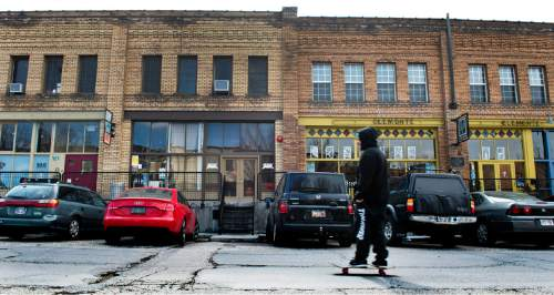 Lennie Mahler  |  The Salt Lake Tribune  A man skateboards down Pierpont Avenue between 300 and 400 West in Salt Lake City, Friday, Feb. 27, 2015. The Eccles Browning Warehouse, a long-time home to small artisan businesses, was sold in January to an out-of-state residential developer.