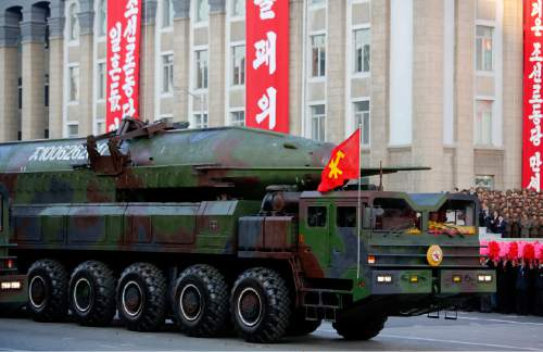 In this Saturday, Oct. 10, 2015, photo, a ballistic missile is paraded in Pyongyang, North Korea during the 70th anniversary celebrations of its ruling party's creation. Pyongyang has long claimed it has the right to develop nuclear weapons to defend itself against the U.S., an established nuclear power with whom it has been in a state of war for more than 65 years. But to build a credible nuclear threat, the North must explode new nuclear devices — including miniaturized ones — so its scientists can improve their designs and technology. (AP Photo/Wong Maye-E)