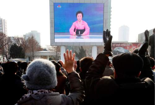 North Koreans watch a news broadcast on a video screen outside Pyongyang Railway Station in Pyongyang, North Korea, Wednesday, Jan. 6, 2016. Pyongyang has long claimed it has the right to develop nuclear weapons to defend itself against the U.S., an established nuclear power with whom it has been in a state of war for more than 65 years. But to build a credible nuclear threat, the North must explode new nuclear devices — including miniaturized ones — so its scientists can improve their designs and technology. (AP Photo/Kim Kwang Hyon)