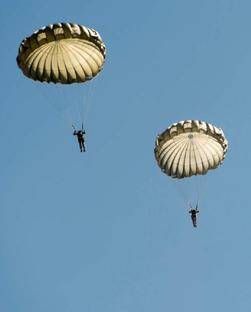 Rick Egan  |  The Salt Lake Tribune  National Guardmembers from 1st Battalion, 19th Special Forces jump from a UH-60 Blackhawk helicopter as Utah Guard Special Forces Conduct Airborne Training in Ephraim, Thursday, August 14, 2014