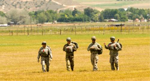 Rick Egan     The Salt Lake Tribune  National Guardmembers from 1st Battalion, 19th Special Forces walk back after a successful jump from a UH-60 Blackhawk helicopter as Utah Guard Special Forces Conduct Airborne Training in Ephraim, Thursday, August 14, 2014