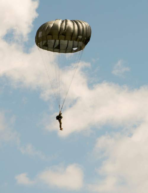 Rick Egan     The Salt Lake Tribune  National Guardmembers from 1st Battalion, 19th Special Forces jump from a UH-60 Blackhawk helicopter as Utah Guard Special Forces Conduct Airborne Training in Ephraim, Thursday, August 14, 2014