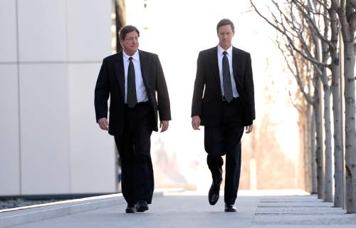 Leah Hogsten  |  The Salt Lake Tribune l-r Lyle Jeffs, believed to be the FLDS bishop in Hildale, Utah, and Colorado City, Arizona, and Nephi Jeffs appeared in U. S. District Court in Salt Lake City, Wednesday, January 21, 2015. Both men, who are Warren Jeffs' brothers, have been served subpoenas in a U.S. Department of Labor lawsuit against Paragon Contractors, that provided labor for the Southern Utah Pecan Ranch near Hurricane. Both businesses are owned by members of the FLDS. Labor department investigators, according to court documents, believe that as many as 1,400 school-age children and their parents participated in the harvest.