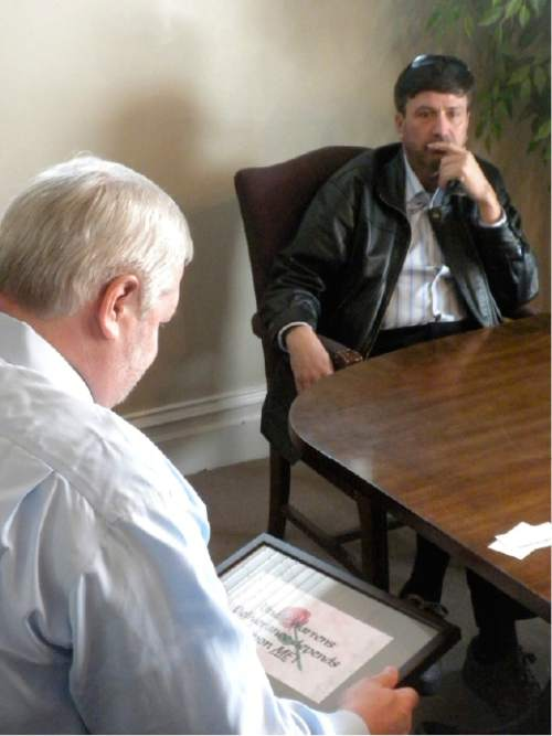 |  Courtesy   Attorney Roger Hoole and his client Wallace Jeffs discuss the United Effort Plan trust, which controls the assets of the FLDS church. The state is working to distribute those assets and Jeffs -- who was ousted from the church in 2010 -- hopes to get one of four properties he worked on while still a member.