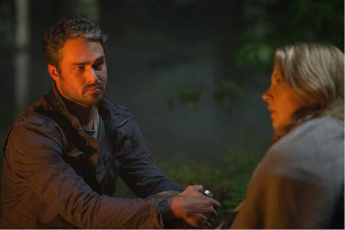 """Aiden (Taylor Kinney, left), a travel writer, assists Sara (Natalie Dormer), who is searching for her missing twin sister in a haunted wood, in the horror thriller """"The Forest."""" Courtesy Gramercy Pictures"""