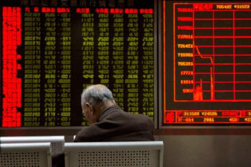 A investor rests near a display board showing the plunge in the Shanghai Composite Index at a brokerage in Beijing, China, Thursday, Jan. 7, 2016. Chinese stocks nosedived on Thursday, triggering the second daylong trading halt of the week and sending other Asian markets sharply lower as investor jitters rippled across the region. (AP Photo/Ng Han Guan)