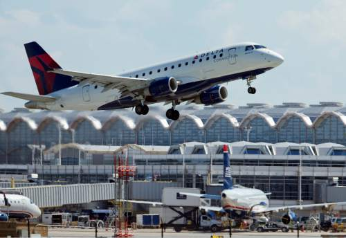 FILE - In this July 28, 2014, file photo, a Delta Air Lines jet takes off from Ronald Reagan Washington National Airport in Arlington, Va. Delta reports quarterly financial results Wednesday, Oct. 14, 2015. (AP Photo/Manuel Balce Ceneta, File)