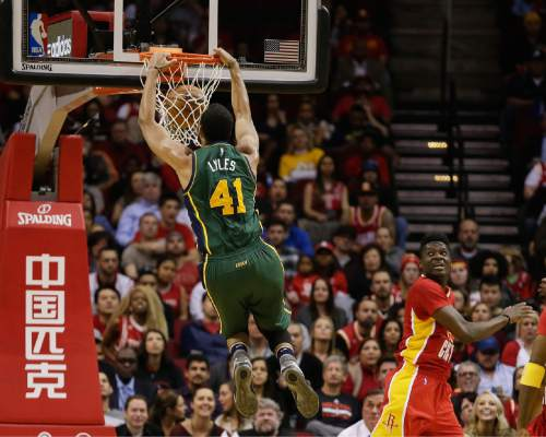 Utah Jazz forward Trey Lyles (41) dunks next to Houston Rockets forward Clint Capela (15) during the first half of an NBA basketball game Thursday, Jan. 7, 2016, in Houston. (AP Photo/Bob Levey)