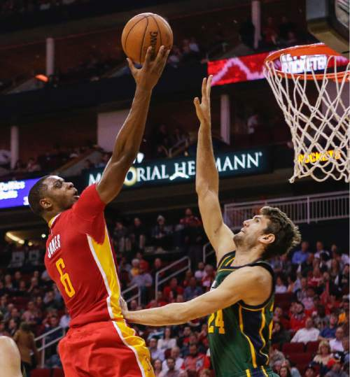 Houston Rockets orward Terrence Jones (6) drives to the basket for a layup on Utah Jazz center Jeff Withey (24) during the first half of an NBA basketball game Thursday, Jan. 7, 2016, in Houston. (AP Photo/Bob Levey)