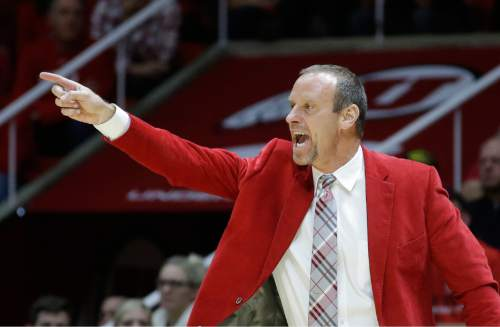 Utah head coach Larry Krystkowiak shouts to his team in the second half during an NCAA college basketball game against BYU Wednesday, Dec. 2, 2015, in Salt Lake City. (AP Photo/Rick Bowmer)