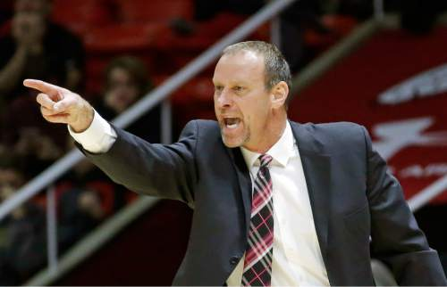 Utah head coach Larry Krystkowiak shouts to his team during the first half of an NCAA college basketball game against Delaware State Tuesday, Dec. 22, 2015, in Salt Lake City.  (AP Photo/Rick Bowmer)