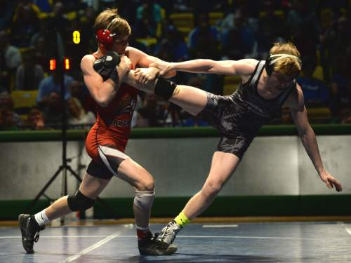 Steve Griffin     The Salt Lake Tribune   American Fork's Cameron Hunsaker, left, drives Maple Mountain's Taylor LaMont backwards during a featured match during the Simplii All-Star Dual, a premier preseason wrestling tournament, at Utah Valley University in Orem, Tuesday, January 5, 2016.