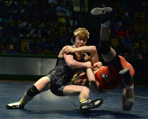 Steve Griffin     The Salt Lake Tribune  Maple Mountain's Taylor LaMont, left, flips American Fork's Cameron Hunsaker, to the ground during a featured match in the Simplii All-Star Dual, a premier preseason wrestling tournament, at Utah Valley University in Orem, Tuesday, January 5, 2016.