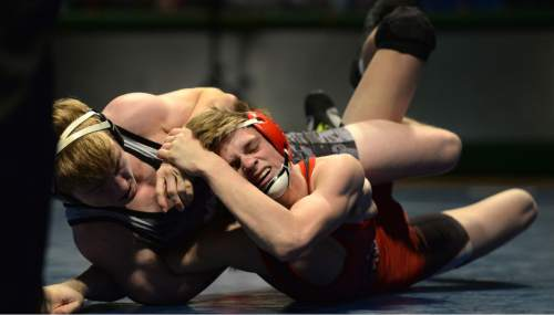 Steve Griffin     The Salt Lake Tribune   American Fork's Cameron Hunsaker, right, struggles to get away from Maple Mountain's Taylor LaMont  during a featured match during the Simplii All-Star Dual, a premier preseason wrestling tournament, at Utah Valley University in Orem, Tuesday, January 5, 2016.