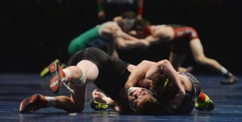 Steve Griffin     The Salt Lake Tribune  High school wrestlers battle on three mats during the Simplii All-Star Dual, a premier preseason wrestling tournament, at Utah Valley University in Orem, Tuesday, January 5, 2016.