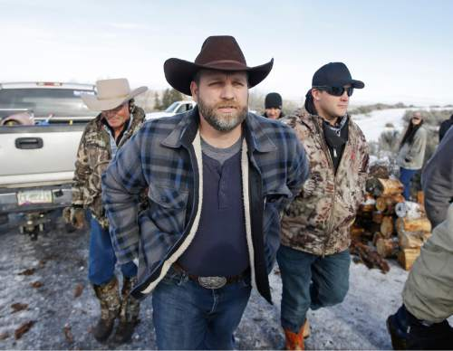 Ammon Bundy, one of the sons of Nevada rancher Cliven Bundy, arrives for a news conference at Malheur National Wildlife Refuge near Burns, Ore., on Wednesday, Jan. 6, 2016. With the takeover entering its fourth day Wednesday, authorities had not removed the group of roughly 20 people from the Malheur National Wildlife Refuge in eastern Oregon's high desert country. (AP Photo/Rick Bowmer)