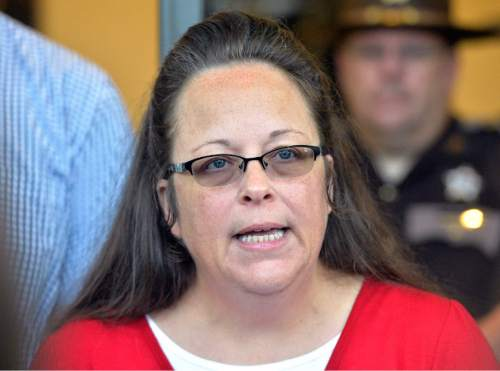 FILE - In this Sept. 14, 2015, file photo Rowan County, Ky. Clerk Kim Davis speaks in Morehead, Ky. Americans place a higher priority on preserving the religious freedom of Christians than other faith groups, ranking Muslims as the least deserving of the protections, according to a new poll from The Associated Press-NORC Center for Public Affairs Research. (AP Photo/Timothy D. Easley, File)
