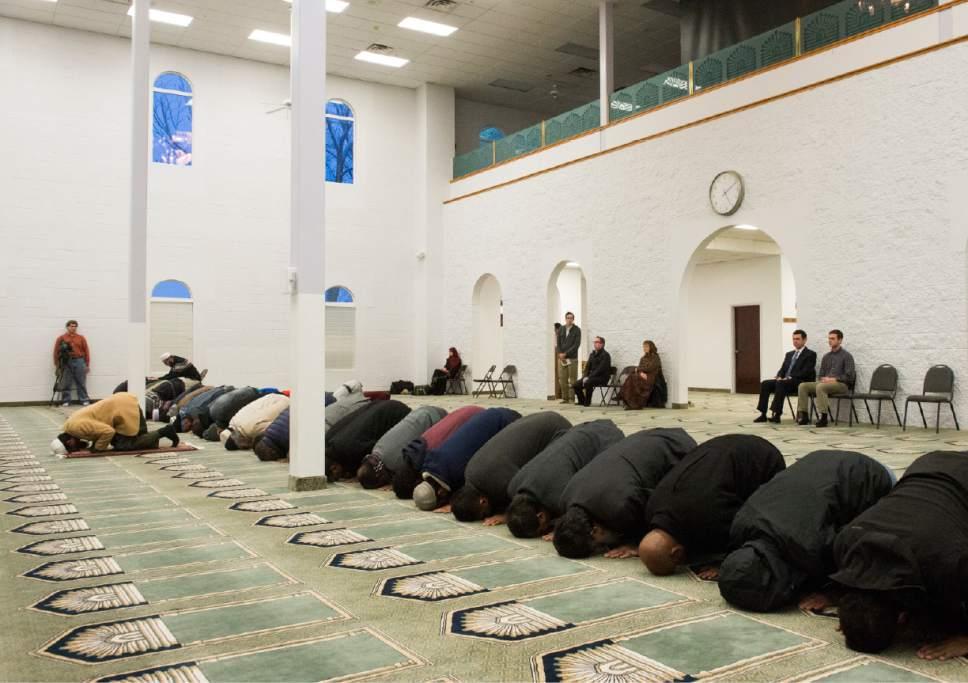 Rick Egan     The Salt Lake Tribune  Imaam Muhammed S. Mehtar leads the prayer at the Khadeeja Islamic Center, as  Rep. Jason Chaffetz and his son Max (right) observe, Monday, December 14, 2015.