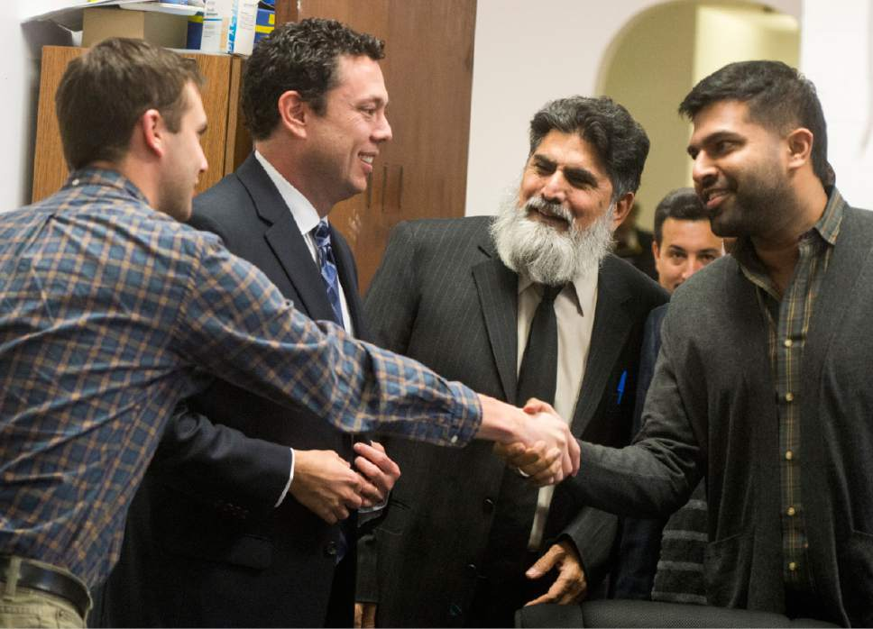 Rick Egan  |  The Salt Lake Tribune  Rep. Jason Chaffetz son Max shakes hands with Avais Ahmed (right) and Abdul Afridi (center) at the Khadeeja Islamic Center, Monday, December 14, 2015.