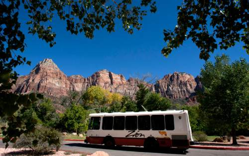 Steve Griffin  |  The Salt Lake Tribune  A shuttle bus leaves the Zion Canyon Village just outside  Zion National Park near Springdale, Utah Monday, September 30, 2013.  The National Park Service handled a record number of visitors last year and expects to break records again in 2016, its centennial year.