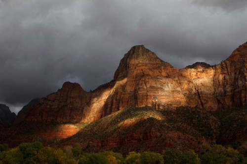 Trent Nelson  |  The Salt Lake Tribune The late afternoon sun lights up the entrance to Zion National Park, Thursday, October 10, 2013.  The National Park Service handled a record number of visitors last year and expects to break records again in 2016, its centennial year.